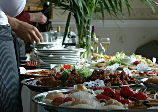 Caterers serving buffet food party